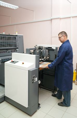 Printer working at his new offset machine Stock Photo - 6064077