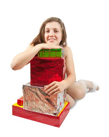 Sexy brunette girl  with few coloured gifts Stock Photo - 6081091