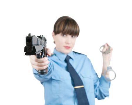 manacles: mujer en uniforme con pistola y esposas sobre blanco, Focus on gau s�lo  Foto de archivo
