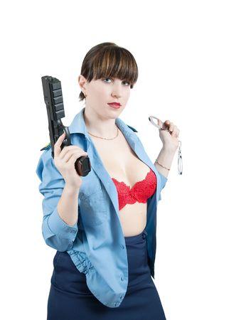 manacles: Mujer sexy en uniforme con pistola y esposas sobre blanco  Foto de archivo