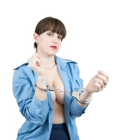 Topless woman in uniform in manacles, isolated over white photo