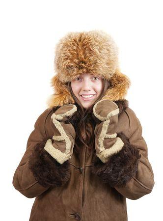 sheepskin: Chica en sheepskin escudo y zorro sombrero sobre fondo blanco Foto de archivo