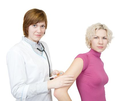 Doctor giving a girl an subdermic injection in arm photo