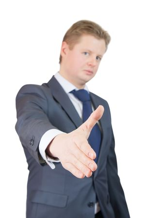 Businessman offering a handshake over white, Focus on hand Stock Photo - 6133033