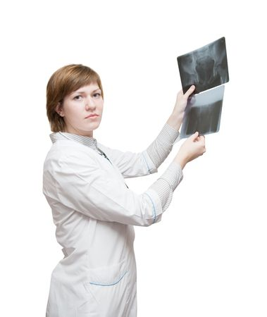 Woman doctor looking at x-ray, isolated over white photo