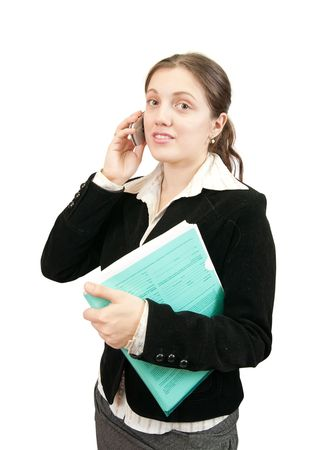 Beautiful girl in business outfit speaking by mobile Stock Photo - 6133126