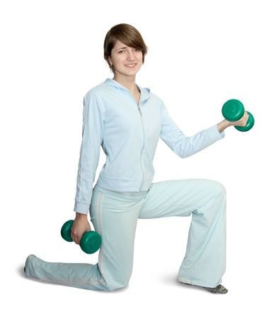 activewear: girl in blue activewear doing fitness exercises with barbell