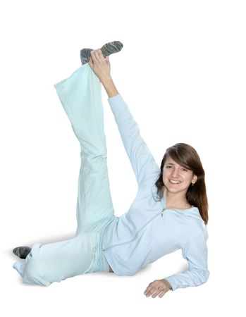 activewear: girl in light activewear is doing fitness exercises  Stock Photo