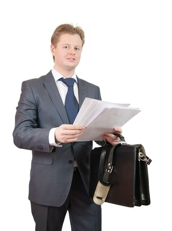 businessman holding brief case and reading documents. Isolated over white photo