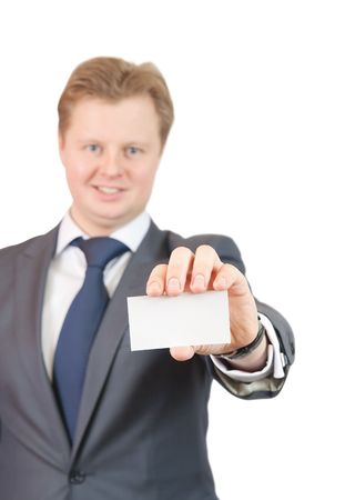 Studio shot of a businessman holding out a blank business card. Focus on card photo