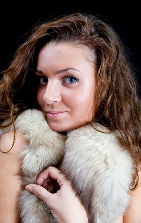 furskin: Portrait of the beautiful girl with  fur Stock Photo