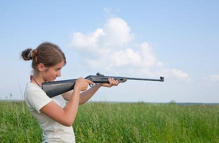 The woman aiming a pneumatic air rifle Stock Photo - 6210382