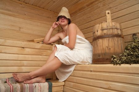 stive: Young woman is taking a steam-bath  at sauna  Stock Photo