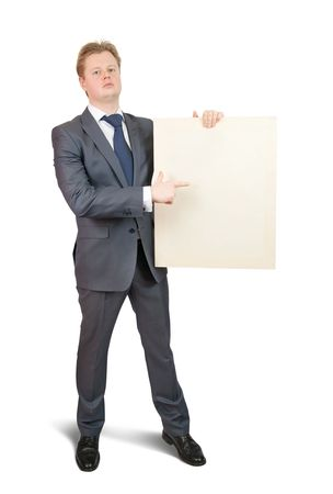 Businessman  in business outfit pointing at blank canvas, over white background photo
