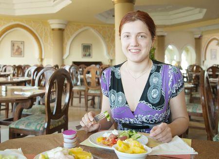 Brunette girl having lunch in the cafe photo