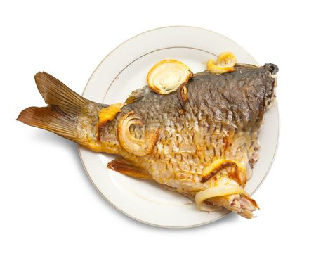 Grilled carp fish  on the white plate over white Stock Photo - 6292461