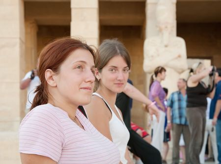 thebes: female tourists against Temple of Hatshepsut at Deir el-Bahri, near Thebes. Luxor, Egypt