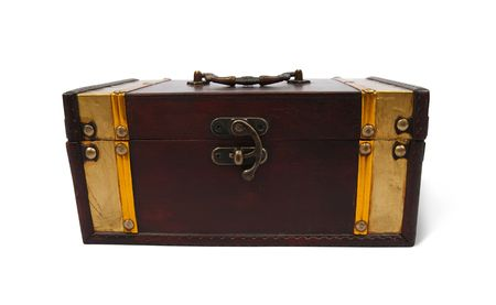 Front view of a treasure chest on a white background with clipping path  photo