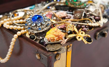 earing: closeup of Treasure chest with many valuables