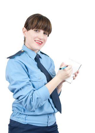 woman in uniform writing something on a notebook over white photo