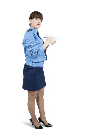woman in uniform writing something on a notebook over white Stock Photo - 6346509