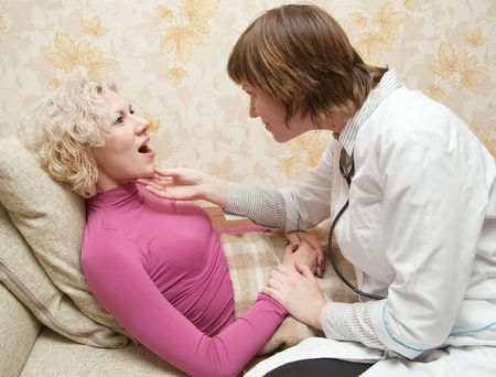 nosotrophy: Female doctor loking to suffering patient on bed