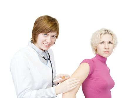 Doctor giving a girl an intramuscular injection in arm over white photo