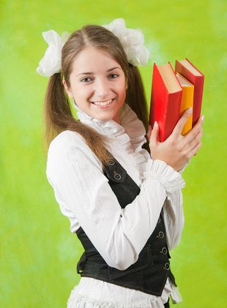 young girl with books over green background photo