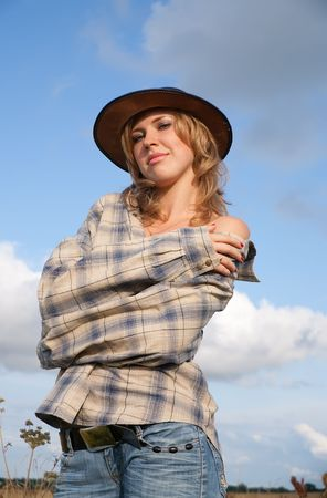 Sexy girl in cowboy hat against sky Stock Photo - 6375064