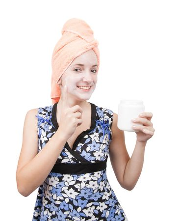 young girl making cosmetic packs. Isolated over white Stock Photo - 6429139
