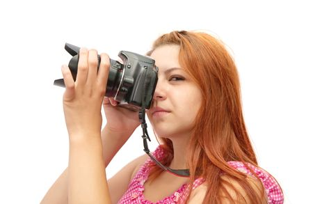 Young girl with camera isolated over white photo
