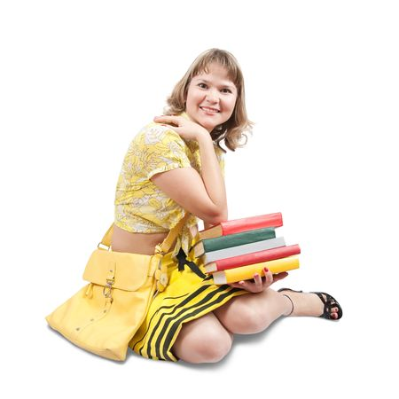 young girl dressed in yellow with books and bag, isolated over white Stockfoto