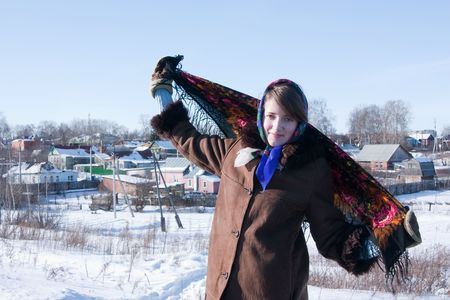 kisser: girl in russian traditional clothes against  winter landscape
