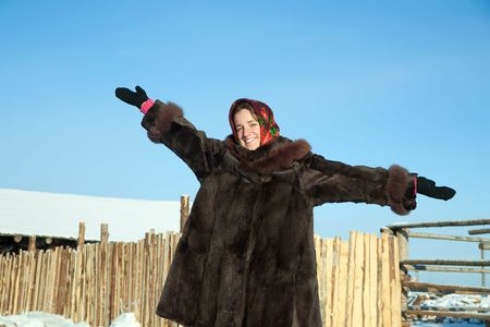 russian ethnicity: girl in russian traditional clothes against  winter rural landscape