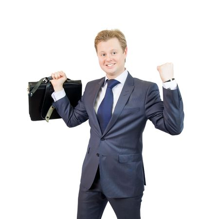 Photo of happy businessman holding brief case  Stock Photo - 6430835