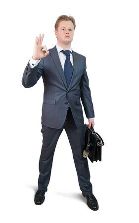 Happy businessman singing OK. Isolated on white photo