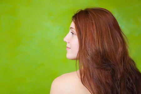 glamur:  portrait of long hair girl over green background Stock Photo