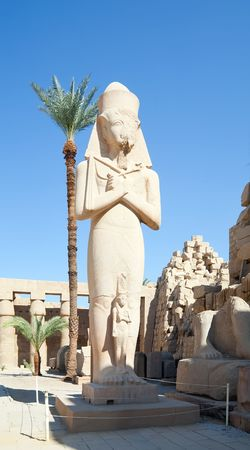 thebes: Pharaoh Ramses II statue in the Temple of Amun-Ra at Karnak. Antique Thebes. Luxor, Egypt.