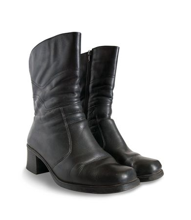 womanish: Black wintry womanish boots  isolated