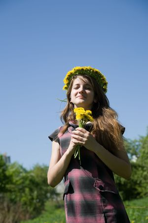 chaplet: long-haired teen girl in chaplet against a meadow Stock Photo