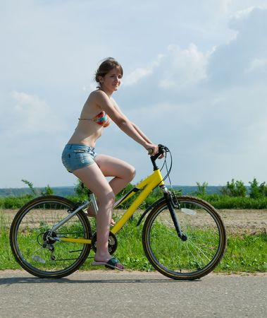 Young girl having riding her bicycles photo
