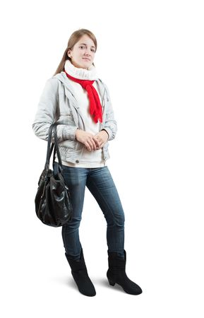 Isolated full length view of girl  in wintry clothes with bag over white photo