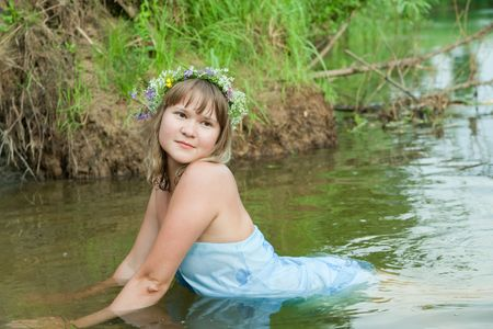 seamaid: Blonde girl  in flower chaplet at river