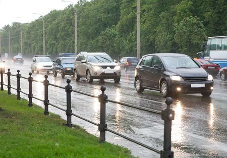 wide wet: Cars on highway on a rainy evening Stock Photo