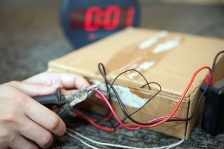 hand deactivationing of  bomb with electronic timer Stock Photo - 6551268