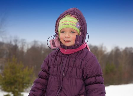 wintery: Little girl in  winter jacket against wintery nature