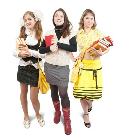 teener: Isolated full length view of three schoolgirls or students with books over white background