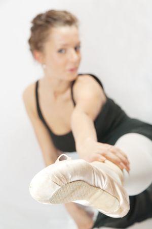 Female dancer exercising on white background. Not isolated photo