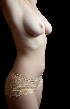 beauty female torso on black background. Low key Stock Photo - 6600778