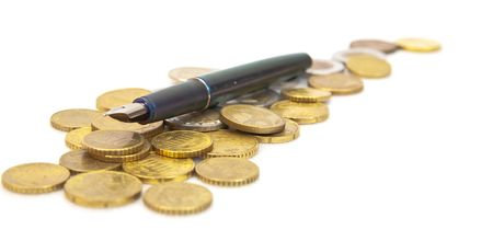 Pen on euro coins  over white background  photo